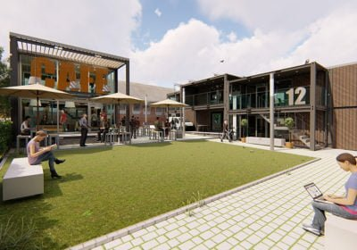 Communal outdoor area surrounded by offices made out of shipping containers