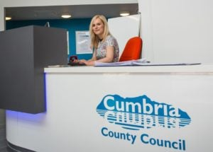 Worker from Cumbria County Council sitting behind a desk