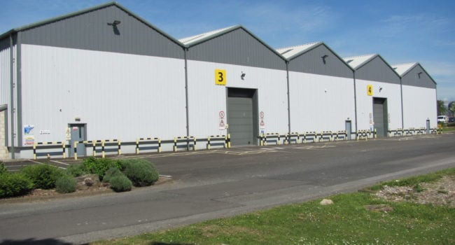 The outside of a large warehouse building, Unit E at Kingmoor Park