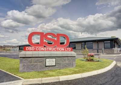 DSD Construction sign in front of their office